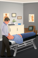 Male Chiropractor Treating a Patient