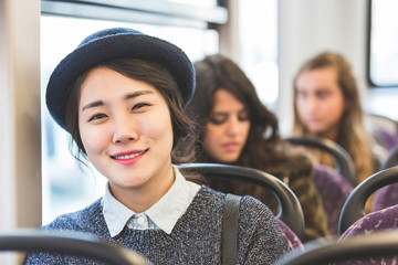 Portrait of an asian girl on a bus