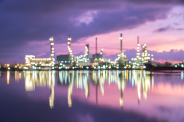 Abstract blur Bokeh of oil refinery, sunrise