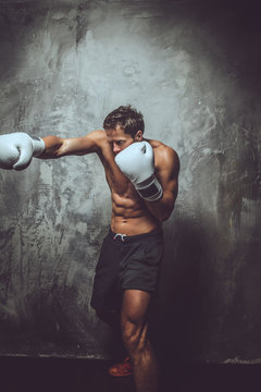 Muscular shirtless fighter.