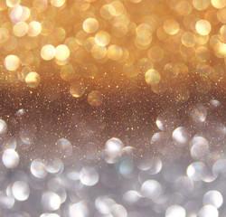 glitter vintage lights background. gold and black. defocused