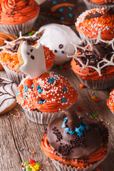 Beautiful Halloween cupcakes with ghosts and witch hat. vertical