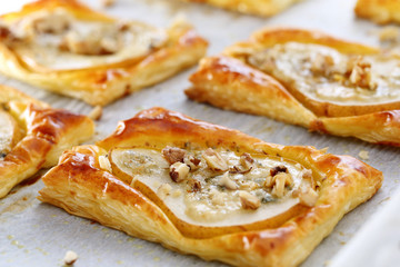 Pears baked in puff pastry with gorgonzola cheese and walnuts