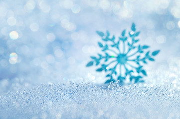 Christmas background with icy blurred decorative snowflake