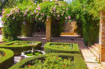 Courtyards and gardens of the famous Palace of the Alcazaba in M