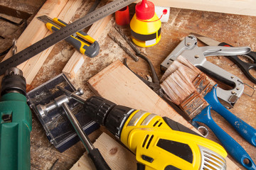Set of different work tools on wooden background