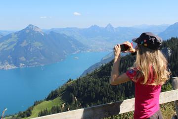 Girl taking photos, switzerland