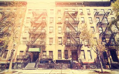 Old film retro style photo of New York street, USA.