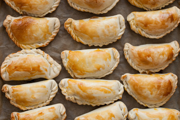 fresh empanadas - traditional food  on baking tray