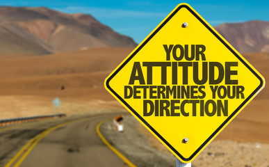 Your Attitude Determines Your Direction sign on desert road