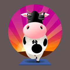 Cow in tree pose with eyes closed in meditation on a yoga mat with a sunset background