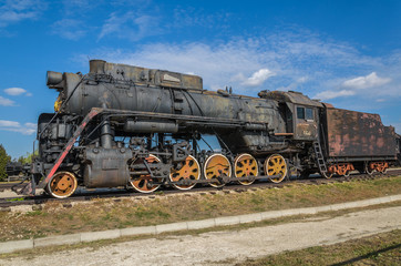 TOGLIATTI, RUSSIA - SEPTEMBER 20, 2015: Steam engine locomotive cl L originally O, produced in 4199 units by Kolomna 1945-1955, displayed at the AvtoVAZ Technical Museum in Togliatti, Samara, Russia