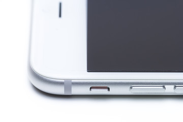 Closeup side view of a smartphone isolate on white background