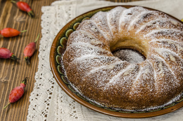 Curd pudding with semolina and apples seeding the powdered sugar