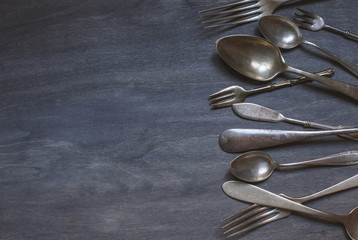 antique cutlery on wooden background