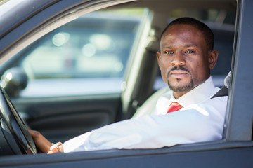 Black guy driving a car