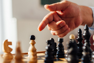 Closeup of a man pointing to the Chess figure