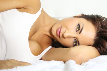 beautiful woman lying in a bed