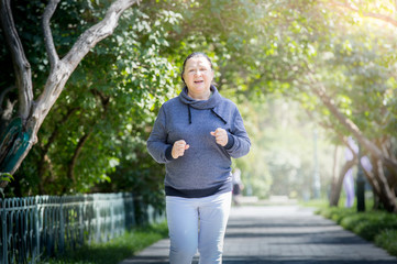 Mature woman jogging in the park. Healthy lifestyle