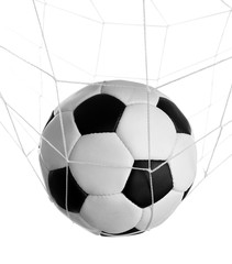 Soccer ball in the net isolated on white
