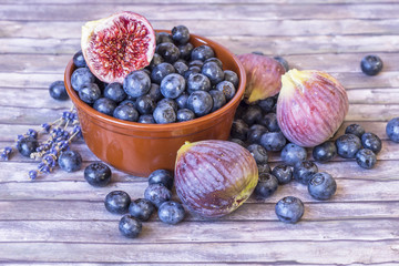 Fresh blueberries and figs in pottery