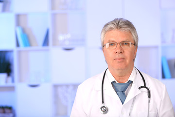 Doctor with stethoscope at his workplace