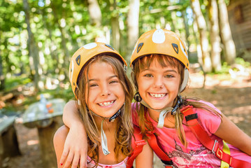 Two happy girlfriends smiling in the adventure park