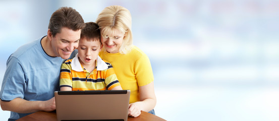 Family with laptop computer.