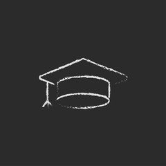 Graduation cap icon drawn in chalk.