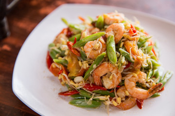 Stir-fry prawn with bean on square white plate