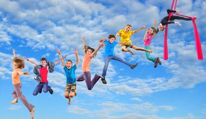 happy dancing jumping children in sky