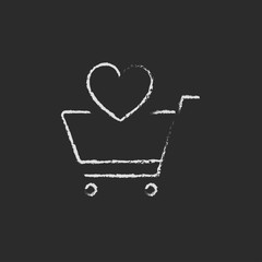 Shopping cart with heart icon drawn in chalk.