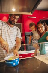 Lovely Family In Kitchen