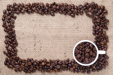 Frame cup of coffee bean with background