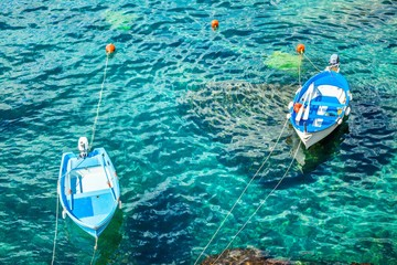 Two old fishing boats in the turquoise waters