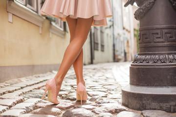 Elegant lady wearing high heels Wall mural