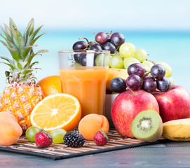 Fresh juice on wooden table