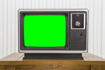 Analogue Portable Television on Table with Green Screen