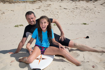 Father and daughter have fun together on holidays surfing