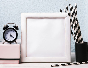 Empty frame, clock and paper straws