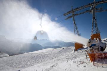 Ski slope, snow canon and gondola