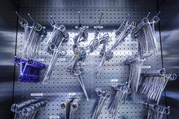 Surgical Instruments Hanging in Stainless Steel Cabinet