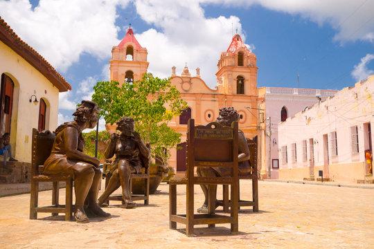 CAMAGUEY, CUBA - SEPTEMBER 4, 2015: Statues, artist Martha Jimenez in front of the Carmen church