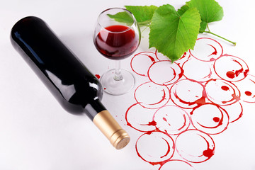 Grapes made with wine cork and goblet and bottle of wine isolated on white