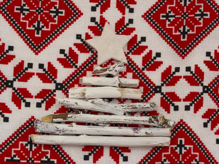 Christmas tree made of white, painted braches