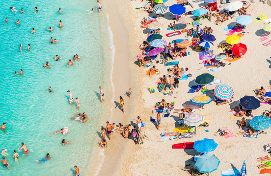 Drone view of Tropea beach, Calabria. Panoramic view of beach with umbrellas top view.