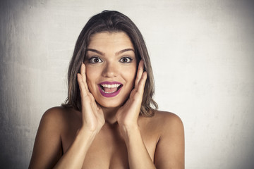 Beautiful woman with surprised expression