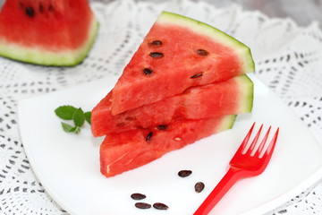 Slices of watermelon on the white plate