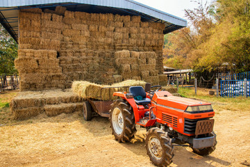 A tractor car in a hay warehouse