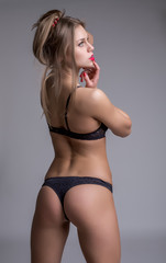 Rear view of underwear model with perfect body